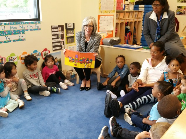 Congresswoman Katherine Clark shares a story with a group of children at the new ABCD Head Start learning center on Commercial Street.