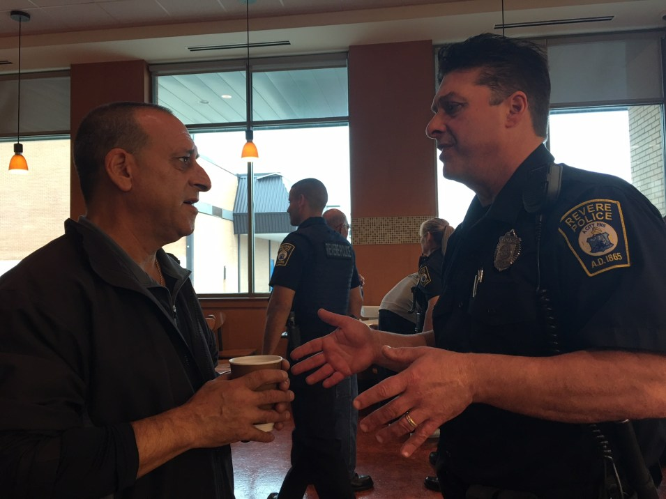Former crossing guard Clifford Pisano, at left, shares his crossing concerns with Officer Jerry Salvati during Wednesday morning's Coffee with a Cop at Market Basket.