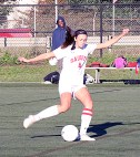 Allison Leblanc kicks a goal for the Sachems deep from midfield early in the game on October 4.