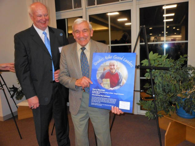 """Edward Jeffrey, chairman of the foundation's board, presents Harry Mazman, one of this year's """"Readers Make Good Leaders"""" honorees."""