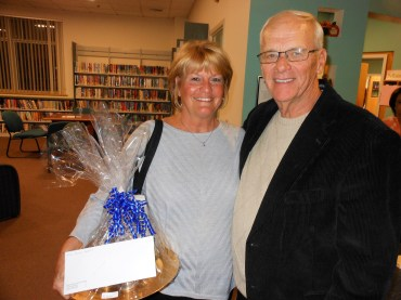 CALLING IT A NIGHT: Debra and Gordon Shepard take home one of the prizes from last Saturday's gala at the Saugus Public Library. Gordon was one of this year's honorees.