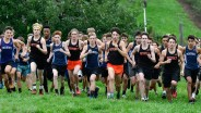 Members of the Peabody boys cross country team take off from the starting line during their cross country meet with Beverly at Brooksby Farm in Peabody on Wednesday, Oct. 3, 2018.