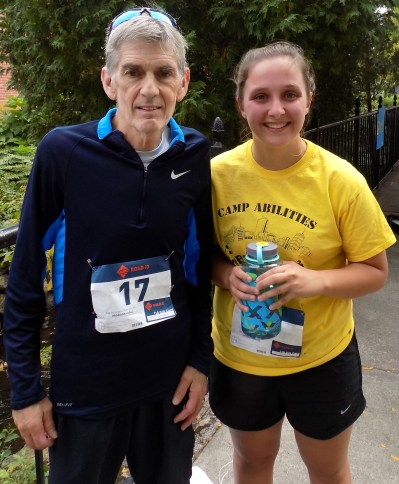 David Farley, 67, and Kaylee Brazell, 23, both of Peabody, enjoy a moment of rest after running in the Richard Foundation to the North Shore's Peabody for Peace 5K and Two-Mile Fun Walk, held last Saturday, October 6. (Advocate photo by Christopher Roberson)