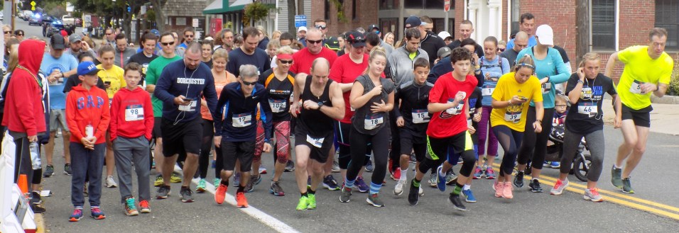 Runners take off from the starting line on Lowell Street.
