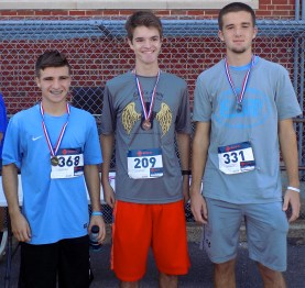 Shown, from left to right, are Guido Iannalfo, 17; Jacob Malionek, 16; and Mike Tansey, 17; all of Peabody. Iannalfo finished in second place with a time of 20 minutes, 47 seconds; Malionek finished in ninth place with a time of 22 minutes, 18 seconds; and Tansey finished in eighth place with a time of 22 minutes, 6 seconds.