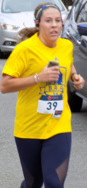 Courtney Marsolais, 27, of Boston, finished in tenth place with a time of 23 minutes, 36 seconds.