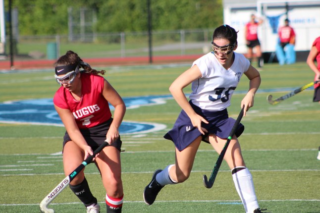 Saugus forward Alessia Salzillo tries to evade Peabody's Lily Bromberger in last Thursday's game at Peabody's Veterans Memorial Stadium.