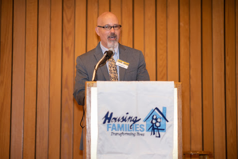 Housing Families CEO Ed Cameron describes his organization's work at this week's Breaking Barrier's Breakfast.