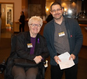 Longtime Housing Families supporter Dee Campbell-Tompkins and panel discussion moderator Nathan Lamb at this week's Breaking Barriers Breakfast.
