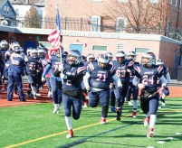 Zack Carifio leads the Patriots onto the field on Thanksgiving