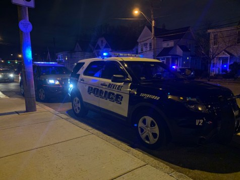 Revere Police cruisers lined the streets for approximately two hours surrounding the Beachmont MBTA station on Saturday night searching for the suspects in backyards, according to MBTA Transit Police. (Advocate photos by Tara Vocino)