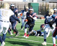It took a team effort to keep the lanes open for big gains by Patriot running back Captain Darius McNeil.