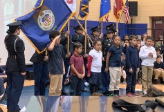 From left to right, Mohamed Bouzaghou, Grade 5, Jonathan Rivera, Kelly Bui, Za Lea Baker, George Sacco and Diego Vigil Zadana get the opportunity to speak like a Marine, guided by Sgt. Dan Clark.