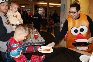 Pizza is always a Halloween favorite for all types of monsters and super heroes. Adam Weldai is helping to serve lots of hungry children enjoying a great Sunday afternoon at the Forestdale School.