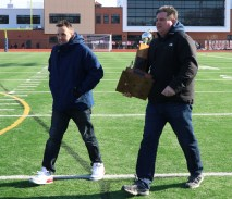 Mayor Brian Arrigo and RHS Athletic Director Frank Shea bring the Thanksgiving Trophy into the field to present to the Patriots for the third year in a row.