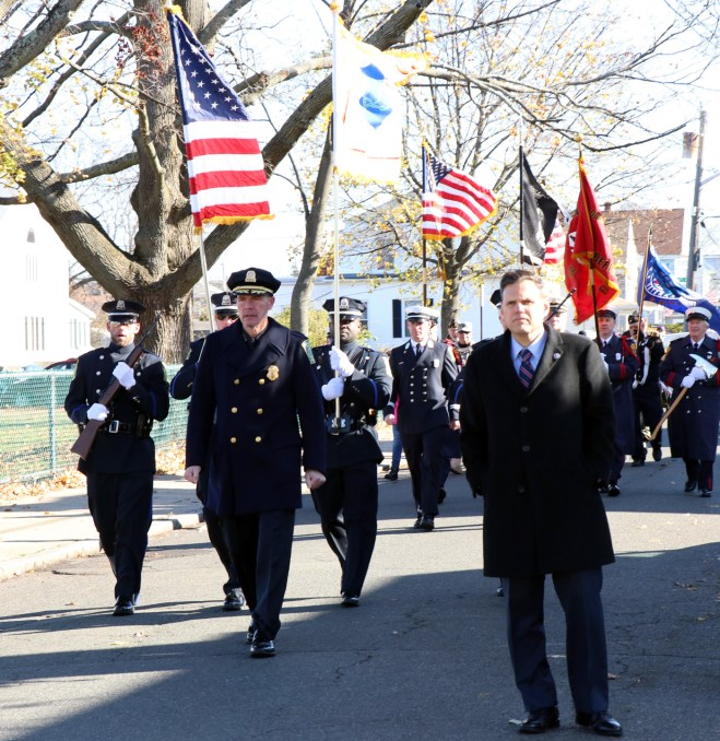 Mayor Gary Christenson leads the way with the Malden Police Dept. close behind.