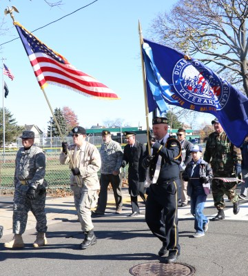 Members of Malden's Disabled American Veterans Chapter 85 are shown marching in the city's Veterans Day Parade Sunday morning. (Advocate photos by Al Terminiello)