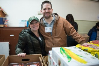 Hayleigh and Aaron Smith of CVS volunteered with the Grace Food Pantry on Sunday morning