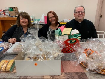 From left to right: Faith Formation Coordinator Donna Marie DeGregorio, Parish Secretary Lee Meoli and Father John Sheridan sell baked goods adjacent to the polling location on Tuesday at St. Mary of the Assumption Parish.