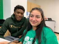 Celtics Center/Forward Rob Williams helps student Araceli Flores with a science project.