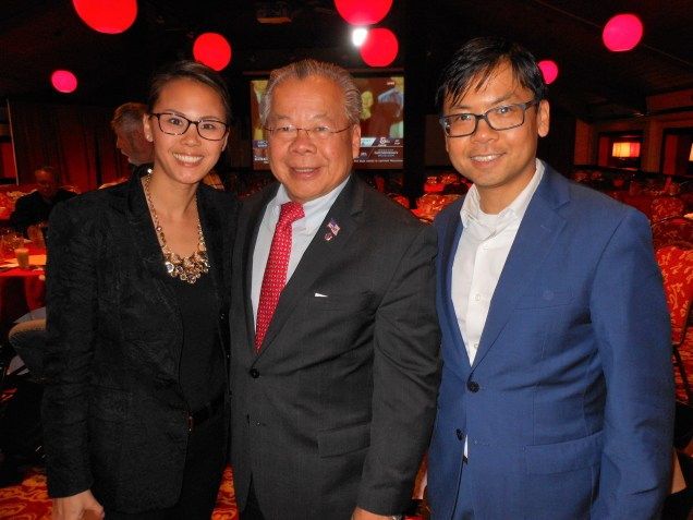 A FAMILY CELEBRATION: State Rep. Donald Wong, center, celebrates at his victory party Tuesday night at Kowloon Restaurant. Joining him are his daughter, Tracie Wong-Myers (left) and his son, Michael Wong (right).