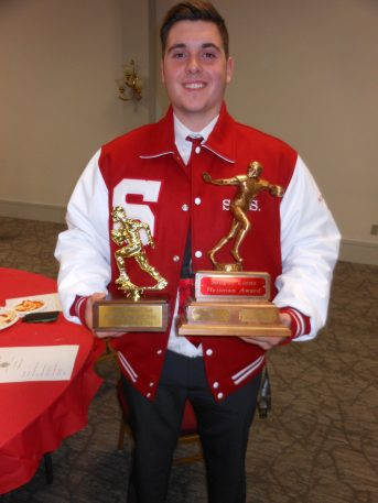 "HOLDING THE HARDWARE: Jake Morgante, star defensive end, offensive tackle and one of three co-captains on this year's Saugus High School football team, displays the Saugus Lions Club ""Heisman Award"" he received Wednesday night (Nov. 14) at the club's 46th Annual Football Meeting and Dinner. The event, which was hosted this year by the Peabody Lions Club at the Holy Ghost Society Hall, is the traditional kickoff to the Thanksgiving Day rivalry between the Saugus High Sachems and the Peabody High Tanners. See more photos from the event in next week's Saugus Advocate. (Saugus Advocate Photo by Mark E. Vogler)"