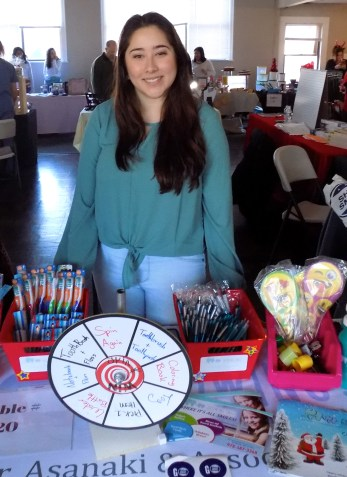 Rayane Neves represented Growing Smile Pediatric Dentistry and Braces during the Small Business Saturday Marketplace on Nov. 24 at the AOH Club. (Advocate Photos by Christopher Roberson)