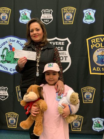 Claudia Cardona and leukemia survivor Emilia Alvarez, 6, display the $5,000 check and teddy bear named Jake that they received from Cops for Kids with Cancer recently. (Advocate photos by Tara Vocino)