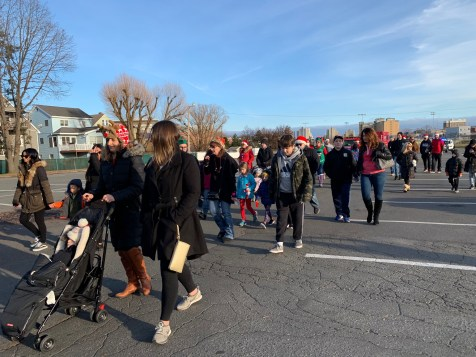 Walkers begin their route at the High School and travel down Broadway for the Santa Walk on Saturday afternoon.