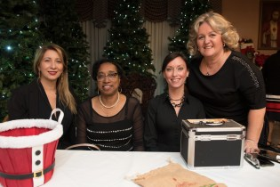 Adriana Machado, Lovita Strain, Valerie Guite, and Marcia Pretto volunteered to sell tickets and collect toy donations.