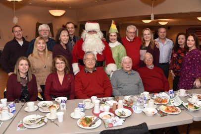 Shown with Santa Claus are, from left to right, (top row) Rob Sipple, Rosemary Ferraro, Don Jacobs, Kathy Cuccinelli, Superintendent David DeRuosi Jr., Scott Brazis, Sparkle the Elf, Dave Carleton, Selectman Jennifer D'Eon, Selectman Mark Mitchell, Director Joanne Olsen, Selectman Debra Panetta, (bottom row) Janine Castro, Deirdre Festa, Kang Yu, Frank Geatter, and Tony Struzziero