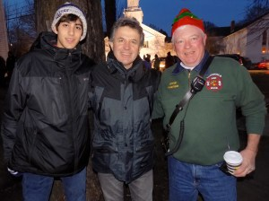 Shown, from left to right, are Andrew Scangas, his father Nicholas and Lynnfield firefighter Steven Furey.