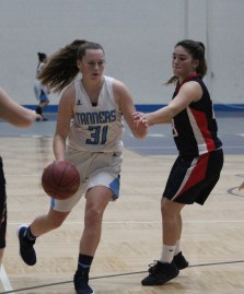 Peabody's Emma Bloom takes it to the hole in last Friday's junior varsity game.