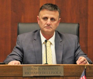 City Council President Richard Dell Isola takes his seat at the head of the City Council.