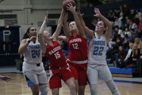 Saugus players Taylor Bogdanski (right) and Kiley Ronan battle for a rebound against Peabody's Colleen Crotty and Liz Zaiter in Tuesday's 61-44 NEC loss to the Tanners.