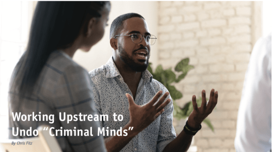 """Working Upstream to Undo """"Criminal Minds"""" - man discussing with peers."""