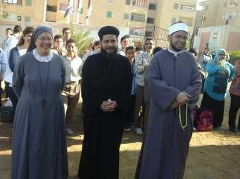 Zusammenarbeit mit Pfarrer und Imam