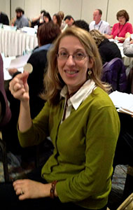 Denise Bortree holds a chip for bartering sessions to be held at the AEJMC annual conference.