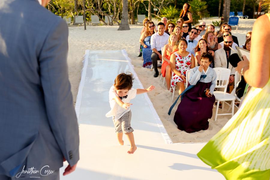Ring bearer running at Grand Sunset Princess Wedding by Jonathan Cossu Photographer