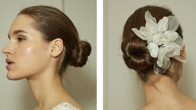 A couple flowers paired with a beautiful chignon