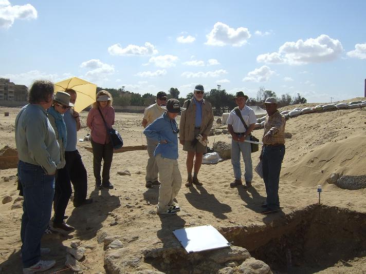 Mark Lehner and donors listen while Ashraf Abd al Aziz explains work at the Chute.