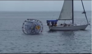 """Bermuda-bound runner Reza Baluchi in floating 'hamster wheel' rescued at sea. - A statement on Baluchi's website said the Iranian exile had planned to make the 1,662-kilometre trip in his self-designed bubble to raise money """"for children in need"""" and """"to … inspire those that have lost hope for a better future."""""""