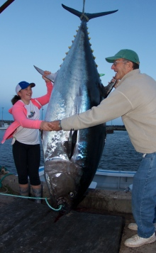 Young woman congratulated for record breaking catch by another record holder.