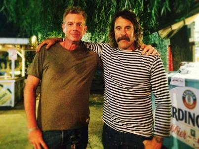 A&E Host Michael Sprouse and legendary surfer/musician Donovan Frankenreiter after his performance at the Bottle & Cork in Dewey, Beach.