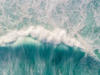 Drone Photo of Wave Crashing on Long Reef Beach