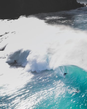 Aerial Of Surfer In Wave