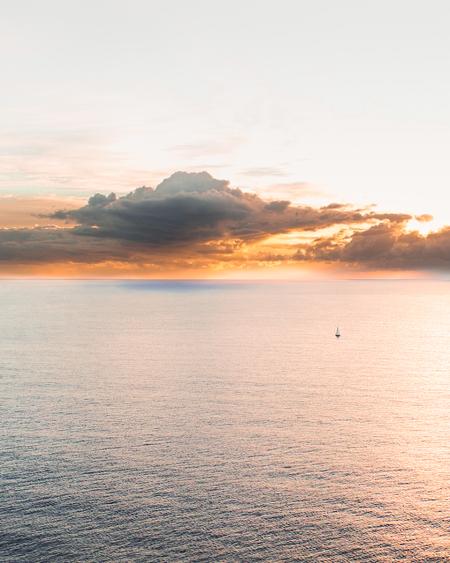 Drone Photo Of Yacht Sailing At Sunrise
