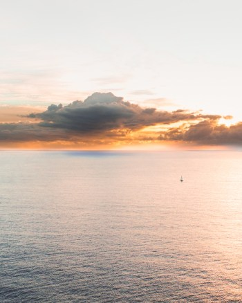Drone Photo Of Yacht Sailing At Sunrise