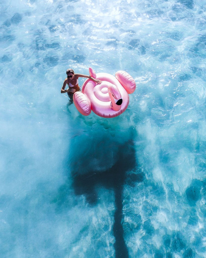 Girl Using Sunnylife Flamingo Inflatable