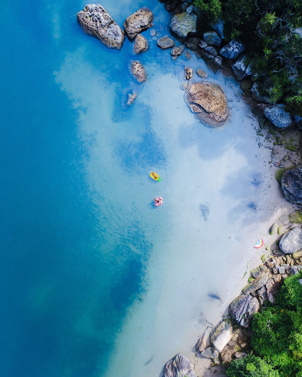 Aerial Of Sunnylife Inflatables At Beach